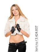 Купить «Стильная блондинка в короткой шубке на белом фоне», фото № 3424837, снято 8 сентября 2010 г. (c) Сергей Сухоруков / Фотобанк Лори