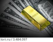 Купить «Слиток золота на пачке денег», фото № 3484097, снято 4 марта 2011 г. (c) ElenArt / Фотобанк Лори