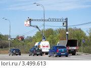 Купить «Обслуживание автоматической дорожной камеры слежения скоростного режима на Дмитровском шоссе», эксклюзивное фото № 3499613, снято 4 мая 2012 г. (c) Елена Коромыслова / Фотобанк Лори