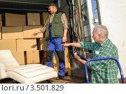 Купить «Два грузчика за работой», фото № 3501829, снято 6 марта 2012 г. (c) CandyBox Images / Фотобанк Лори