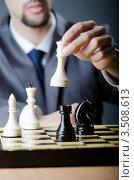 Купить «Мужчина делает ход ферзем, играя в шахматы», фото № 3508613, снято 6 февраля 2012 г. (c) Elnur / Фотобанк Лори