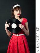 Купить «Девушка в красном платье с граммофонной пластинкой», фото № 3511921, снято 7 марта 2012 г. (c) Юрий Андреев / Фотобанк Лори