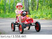Купить «Девочка на игрушечной машине», фото № 3558441, снято 1 июня 2012 г. (c) Хайрятдинов Ринат / Фотобанк Лори