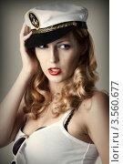 Купить «Сексуальная блондинка в капитанской  фуражке», фото № 3560677, снято 2 июня 2012 г. (c) katalinks / Фотобанк Лори