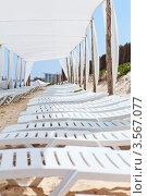 Купить «Ряд пластиковых лежаков под защитным навесом на пляже», фото № 3567077, снято 1 мая 2012 г. (c) Кекяляйнен Андрей / Фотобанк Лори