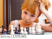 Купить «Мальчик играет в шахматы», фото № 3570965, снято 14 февраля 2012 г. (c) Anelina / Фотобанк Лори