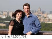 Купить «Семейная пара средних лет на фоне города», эксклюзивное фото № 3574769, снято 7 мая 2012 г. (c) Дмитрий Неумоин / Фотобанк Лори