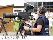 Видеооператор за работой (2012 год). Редакционное фото, фотограф Галина Щурова / Фотобанк Лори