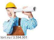 Купить «Счастливый мужчина в желтой каске смотри в рулон бумаги как в подзорную трубу», фото № 3594901, снято 14 марта 2012 г. (c) Дмитрий Калиновский / Фотобанк Лори