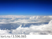 Купить «Вид из самолёта на белые кучевые облака и синее небо», фото № 3596065, снято 31 мая 2012 г. (c) Vitas / Фотобанк Лори