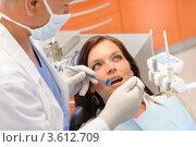 Купить «Стоматолог осматривает ротовую полость девушки», фото № 3612709, снято 29 апреля 2012 г. (c) CandyBox Images / Фотобанк Лори