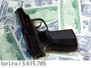 Купить «Пистолет и доллары», фото № 3615785, снято 27 ноября 2009 г. (c) Александр Скопинцев / Фотобанк Лори