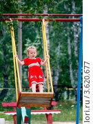 Купить «Маленькая девочка качается на качелях стоя», фото № 3620677, снято 23 июня 2012 г. (c) Хайрятдинов Ринат / Фотобанк Лори
