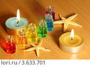 Купить «Шесть флаконов с разноцветными ароматическими маслами, свечи и морские звезды на столе», фото № 3633701, снято 14 апреля 2011 г. (c) Losevsky Pavel / Фотобанк Лори