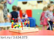 Купить «Красочная игрушка на деревянной подставке на столе в детском саду», фото № 3634073, снято 5 марта 2011 г. (c) Losevsky Pavel / Фотобанк Лори