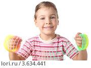 Купить «Маленькая девочка играет с радугой-пружиной», фото № 3634441, снято 26 мая 2010 г. (c) Losevsky Pavel / Фотобанк Лори
