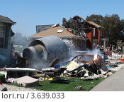 Купить «Место крушения самолета: турбина самолета, упавшая на жилой дом», фото № 3639033, снято 14 мая 2012 г. (c) SummeRain / Фотобанк Лори