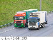 Купить «Грузовики DAF и Volvo на МКАД», эксклюзивное фото № 3644393, снято 23 июня 2012 г. (c) Алёшина Оксана / Фотобанк Лори