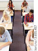 Купить «Студенты сдают экзамен», фото № 3655457, снято 10 августа 2011 г. (c) Monkey Business Images / Фотобанк Лори