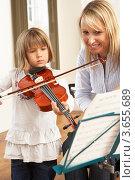 Купить «Девочка учится играть на скрипке в музыкальной школе», фото № 3655689, снято 5 сентября 2011 г. (c) Monkey Business Images / Фотобанк Лори