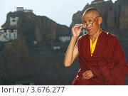 Купить «Буддийский монах на фоне монастыря в горах», фото № 3676277, снято 1 июля 2012 г. (c) Дмитрий Калиновский / Фотобанк Лори