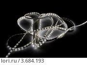 Купить «Свёрнутая лента с белыми светодиодами на тёмном фоне», фото № 3684193, снято 18 марта 2012 г. (c) Абышев А.А. / Фотобанк Лори
