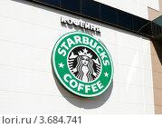 """Логотип кофейни """"Старбакс"""" на стене, фото № 3684741, снято 3 мая 2012 г. (c) Андрей Ерофеев / Фотобанк Лори"""