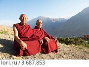 Купить «Два тибетских монаха сидят на фоне гор», фото № 3687853, снято 1 июля 2012 г. (c) Дмитрий Калиновский / Фотобанк Лори
