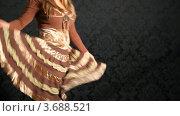 Купить «Молодая девушка в полосатой юбке танцует», видеоролик № 3688521, снято 15 марта 2010 г. (c) Losevsky Pavel / Фотобанк Лори