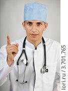 Купить «Молодой врач в спецодежде на светлом фоне», фото № 3701765, снято 22 июля 2012 г. (c) Gagara / Фотобанк Лори