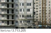 Купить «Рабочие на строительной площадке зимой, таймлапс», видеоролик № 3713205, снято 23 сентября 2010 г. (c) Losevsky Pavel / Фотобанк Лори