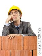 Купить «Озадаченный инженер облокотился на кирпичную стену», фото № 3720129, снято 22 мая 2012 г. (c) Elnur / Фотобанк Лори