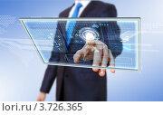 Купить «Мужчина в деловом костюме нажимает на кнопку на виртуальной панели», фото № 3726365, снято 27 апреля 2012 г. (c) Sergey Nivens / Фотобанк Лори