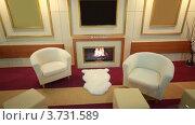 Купить «Интерьер с камином, креслами и телевизором», видеоролик № 3731589, снято 28 декабря 2010 г. (c) Losevsky Pavel / Фотобанк Лори