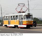 Купить «Желтый трамвай на Строгинском мосту, маршрут №30», фото № 3731777, снято 7 августа 2012 г. (c) Андрей Ерофеев / Фотобанк Лори