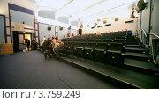 Купить «Люди проходят в кинозал», видеоролик № 3759249, снято 13 ноября 2011 г. (c) Losevsky Pavel / Фотобанк Лори