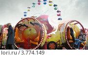 Купить «Аттракционы в парке Сокольники(таймлапс)», видеоролик № 3774149, снято 10 января 2012 г. (c) Losevsky Pavel / Фотобанк Лори