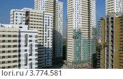 Купить «Новые многоэтажные дома стоят на фоне синего неба, таймлапс», видеоролик № 3774581, снято 25 января 2012 г. (c) Losevsky Pavel / Фотобанк Лори