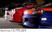 Купить «Три спортивных автомобиля на старте», видеоролик № 3775421, снято 19 января 2012 г. (c) Losevsky Pavel / Фотобанк Лори