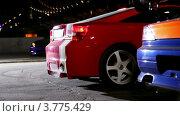 Купить «Несколько спортивных автомобилей», видеоролик № 3775429, снято 25 января 2012 г. (c) Losevsky Pavel / Фотобанк Лори