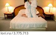 Купить «Мужчина и женщина в банных халатах входят в спальню и встают на колени на кровать и держатся за руки», видеоролик № 3775713, снято 12 марта 2012 г. (c) Losevsky Pavel / Фотобанк Лори