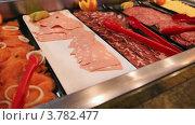 Купить «Рыбная и мясная нарезка в буфете», видеоролик № 3782477, снято 2 июня 2012 г. (c) Losevsky Pavel / Фотобанк Лори