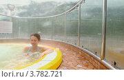 Купить «Женщина в бассейне с горячей водой», видеоролик № 3782721, снято 19 июня 2012 г. (c) Losevsky Pavel / Фотобанк Лори
