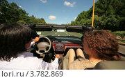 Купить «Мужчина и женщина едут в кабриолете по асфальтовой дороге среди деревьев», видеоролик № 3782869, снято 28 апреля 2012 г. (c) Losevsky Pavel / Фотобанк Лори