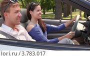 Купить «Молодой человек и девушка сидят на переднем сидении в кабриолете и улыбаются летним днем», видеоролик № 3783017, снято 28 апреля 2012 г. (c) Losevsky Pavel / Фотобанк Лори