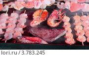 Купить «Мясо, рыба и морепродукты на гриле», видеоролик № 3783245, снято 18 мая 2012 г. (c) Losevsky Pavel / Фотобанк Лори