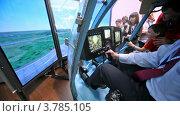 Купить «Пилот управляет тренажером вертолета на международной выставке», видеоролик № 3785105, снято 30 июля 2012 г. (c) Losevsky Pavel / Фотобанк Лори