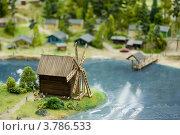 Купить «Мельница на берегу реки. Макет», фото № 3786533, снято 28 апреля 2012 г. (c) Сурикова Ирина / Фотобанк Лори