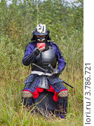 Купить «Самурай в доспехе пьет из чаши», фото № 3786721, снято 25 августа 2012 г. (c) Иван Марчук / Фотобанк Лори