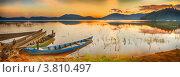 Купить «Лодки на берегу озера Лак на закате», фото № 3810497, снято 30 августа 2012 г. (c) Ольга Хорошунова / Фотобанк Лори